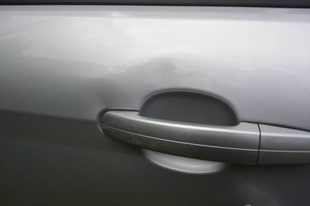 fixing car door dent